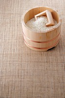 Uncooked rice in a bamboo tub