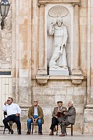 Italy, Apulia, Ostuni, People talking in front a church