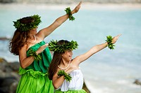 Hawaii, Maui, Mother and daughter dancing hula together.