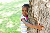 Girl 6_7 embracing tree