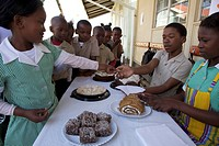 Schoolchildren buying slices of cake at a school cake sale, KwaZulu Natal Province, South Africa