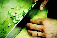 Chef cutting courgettes