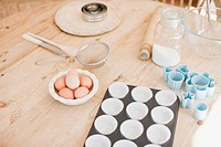 Eggs and baking supplies on kitchen table