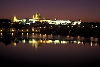 palace, Prague, Vltava River, Czech Republic, Praha, Central Bohemia, Prague Castle reflects in the calm waters of the Vltava River at night.