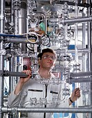Engineer checking distilling apparatus in alcohol manufacturing