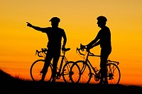 Bicycle riders relaxing watching sunset