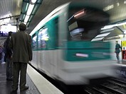 Subway train arriving in Metro station, Paris, Ile_de_France, France