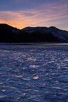 A frozen Donner Lake California at sunset