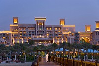 United Arab Emirates, Dubai, Al Qasr Hotel, built in the style of a Moroccan palace, seen from the pier leading out to the Pier Chic restaurant.