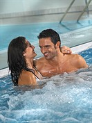 Couple in jacuzzi bath tube