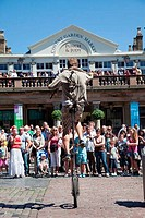 UK, England, London, Covent Garden, street performer on unicycle