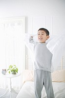 Boy standing in bed