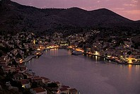 High angle view of a town lit up at the waterfront, Symi, Dodecanese Islands, Greece