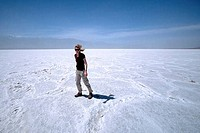 Young woman standing on salt flats, Badwater, Death Valley National Park, California, USA