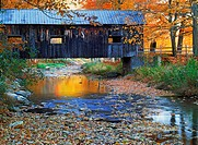 Old covered bridge amid fall foliage near Grafton, Vermont in New England