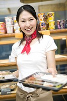 Young woman serving lunch box