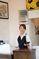 Cashier at checkout counter