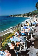 People dining at terrace restaurant in Laguna Beach, California