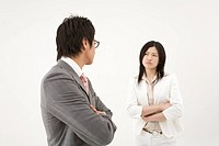Two business people glaring at each other