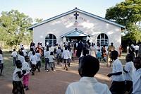 Zimbabwe, Mashonaland Central, Nyachuru Township. May 2010. End of the Sunday Service at the Salvation Army Nyachuru Citadel.