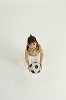 Girl holding soccer ball