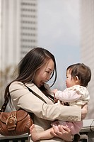 Businesswoman holding baby
