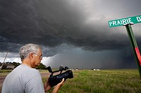 Storm chaser and scientist Tim Marshall videotapes a developing tornado near Scottsbluff, Nebraska, June 7, 2010