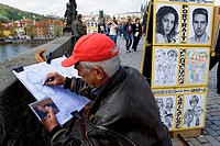 Cartoonist Drawing Picture of photo  In charles bridge Prague  Czech Republic