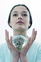 Woman with glass globe