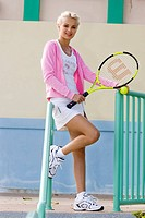 Young woman wearing tennis outfit