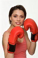 Portrait of woman boxing with boxing gloves