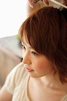 Young woman having hair cut