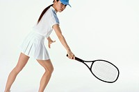 Female tennis player preparing to hit ball