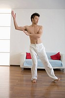 Asian man doing Tai chi chuan