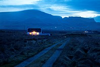 Scotland, Isle of Skye, Staffin. Dusk over the village of Staffin on the Trotternish peninsula with the Quiraing beyond.
