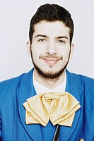 Portrait of a young man grinning in traditional clothing
