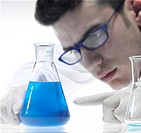 Close up of scientist working with volumetric flasks