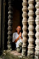 CAMBODIA, ANGKOR, ANGKOR WAT, GALLERY, OLD MAN IN WINDOW