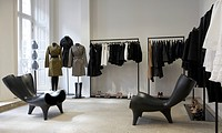 DOVER STREET MARKET, REI KAWAKUBO, 2006, LONDON, VIEW OF WOMENSWEAR WITH MARC NEWSON CHAIRS IN FOREGROUND
