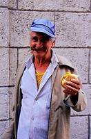 CUBA, OLD HAVANA, STREET SCENE, MAN WITH CIGAR AND SANDWICH