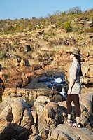 Woman at Bourke´s Luck Potholes, Blyde River Canyon, Drakensberg Escarpment, Mpumalanga, South Africa MR