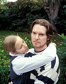 Young couple embracing in park,portrait