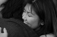 Young couple embracing each other,close up B&W