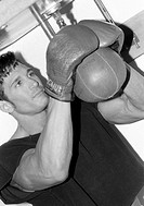 Young man practicing boxing, close up