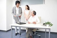 Three people working in office