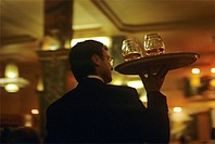 France, Paris, waiter with tray of drinks