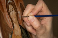 Detail of an artist painting a religious icon