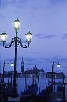 Italy, Veneto, Venice, gondolas and view on island San Giorgio Maggiore