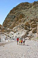 family hiking in Titus Canyon in Death Valley National Park California