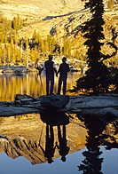 reflection couple hiking Ottoway Lake Yosemite National Park